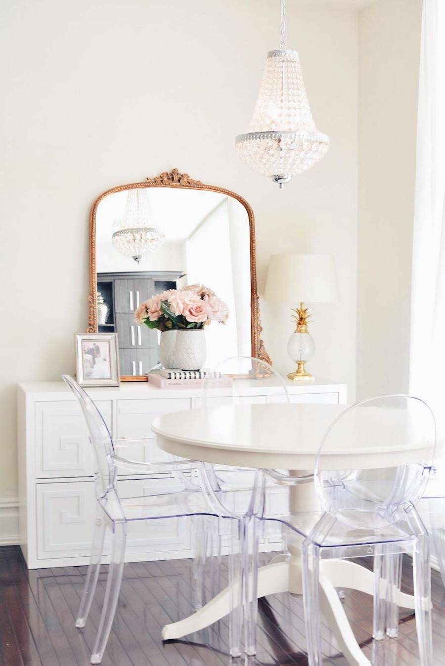 Vintage gold gilded mirror in white dining room via The Pink Dream