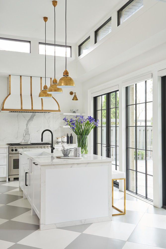 3 Brass Pendant Lights Above Marble Kitchen Island