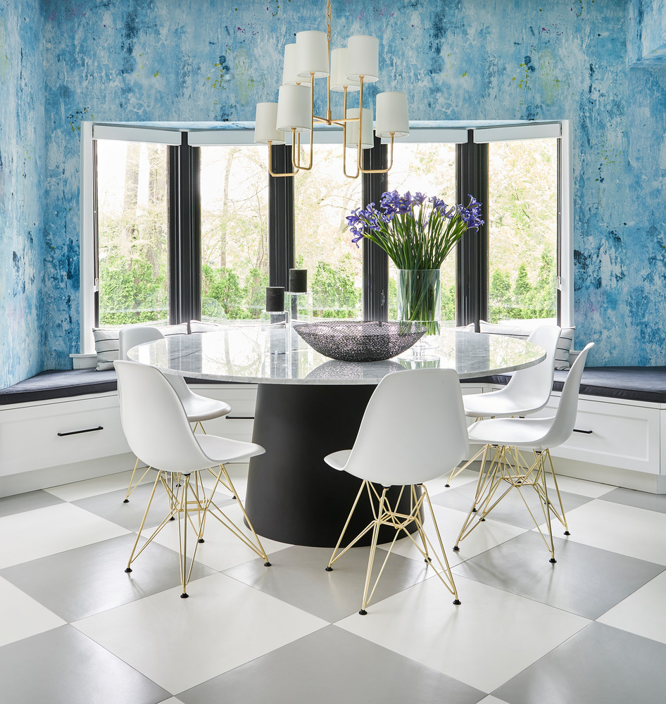 Large Breakfast Nook With Blue Water Wallpaper Marble Table And White Chairs