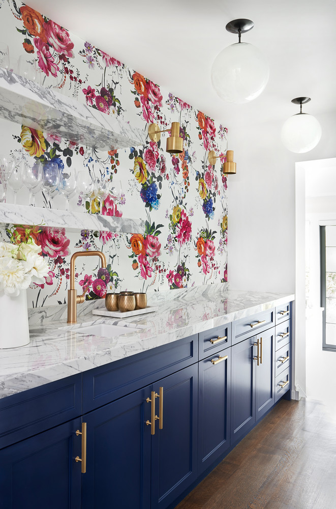 Marble Kitchen Counter, Navy Blue Kitchen Cabinets And Floral Wallpaper Behind Brass Sink