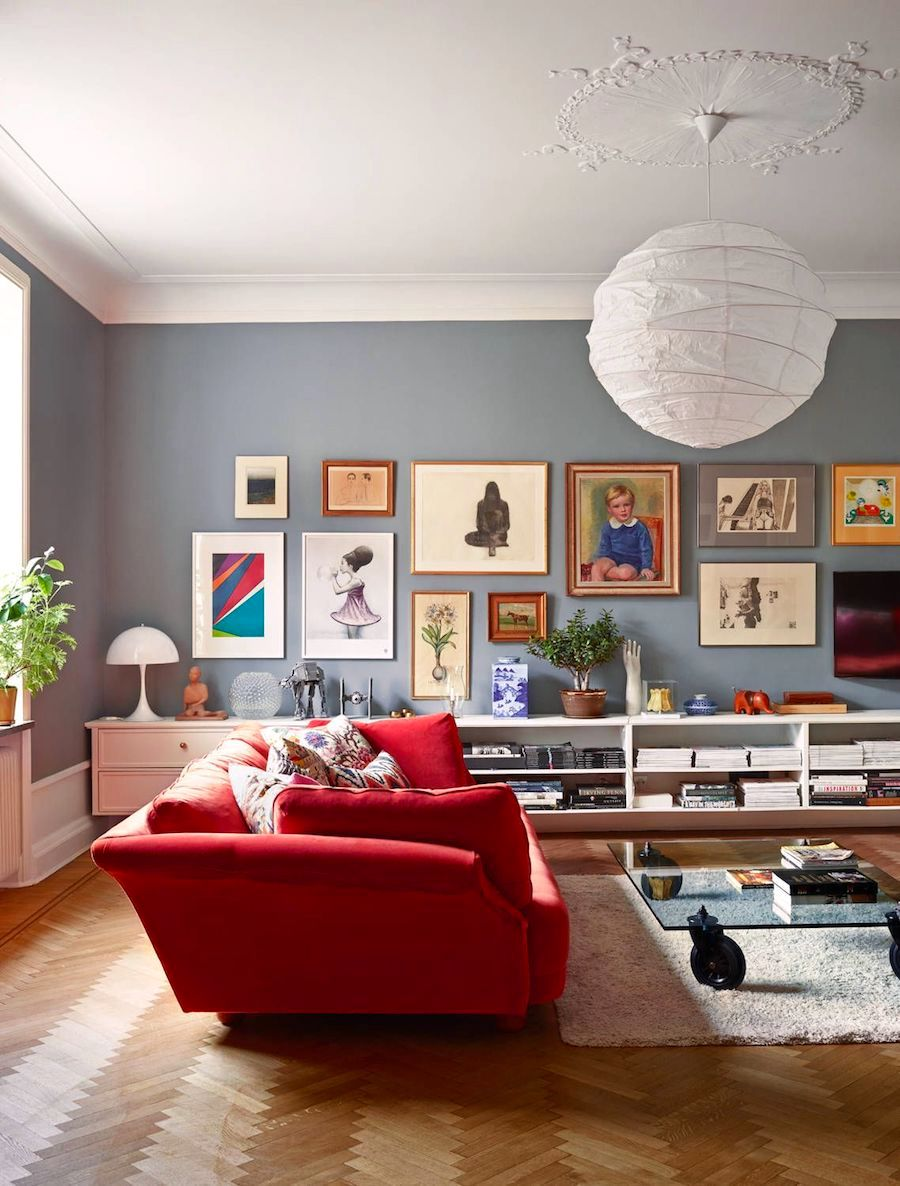 Red Sofa Ideas Herringbone Wood Flooring Gallery Wall via West Elm