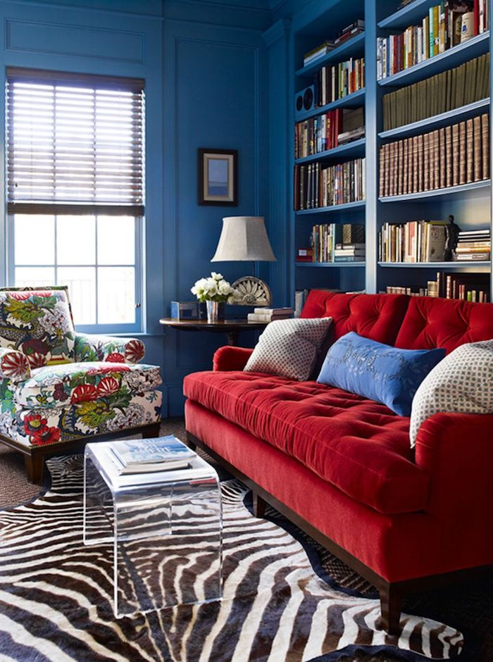 Rose Red Tufted Sofa With Dark Blue Walls And Floral Chair By Katie Ridder