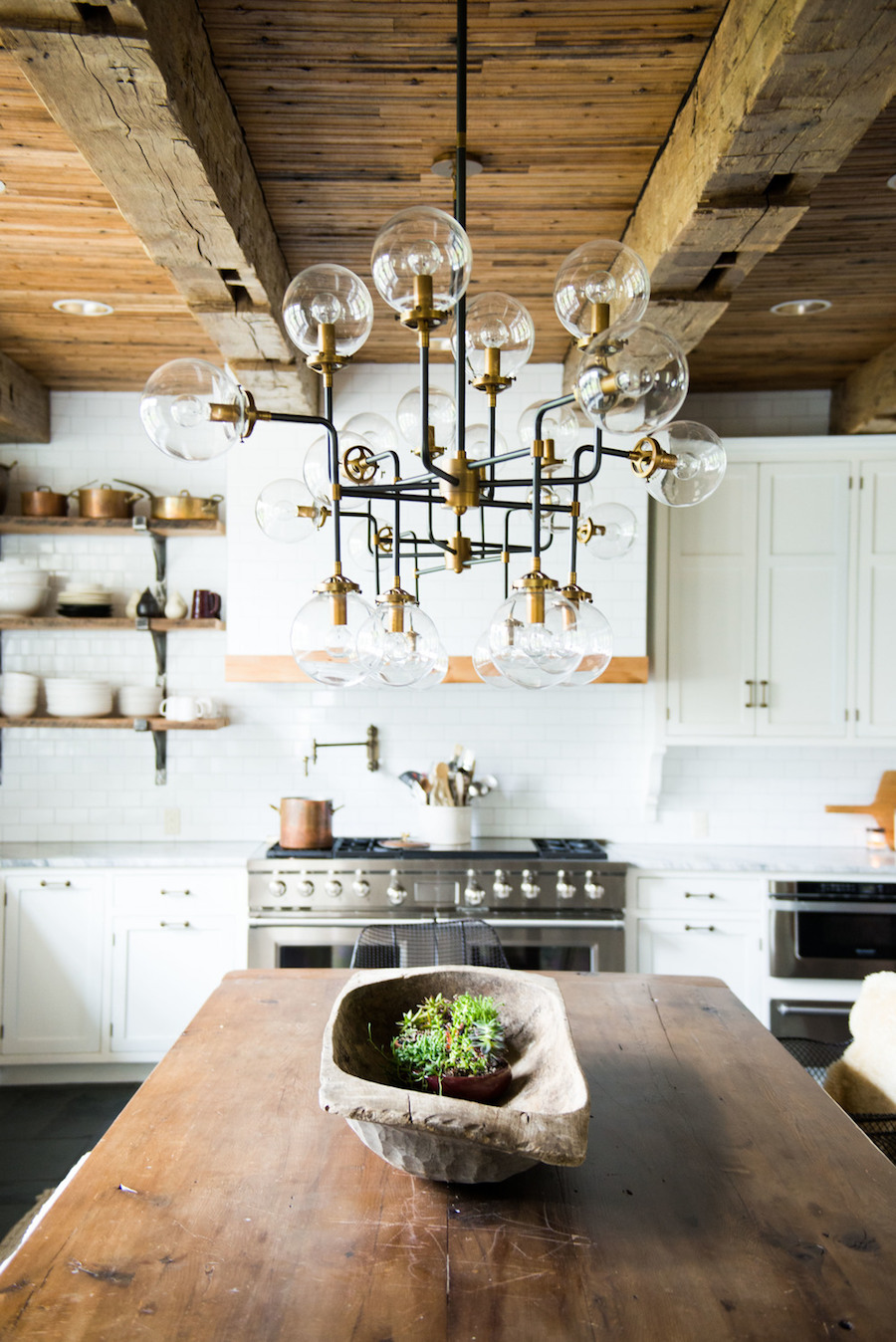 Rustic Wood Kitchen Island and Brass Chandelier with Real Wood Beam Ceiling via Midland Architecture