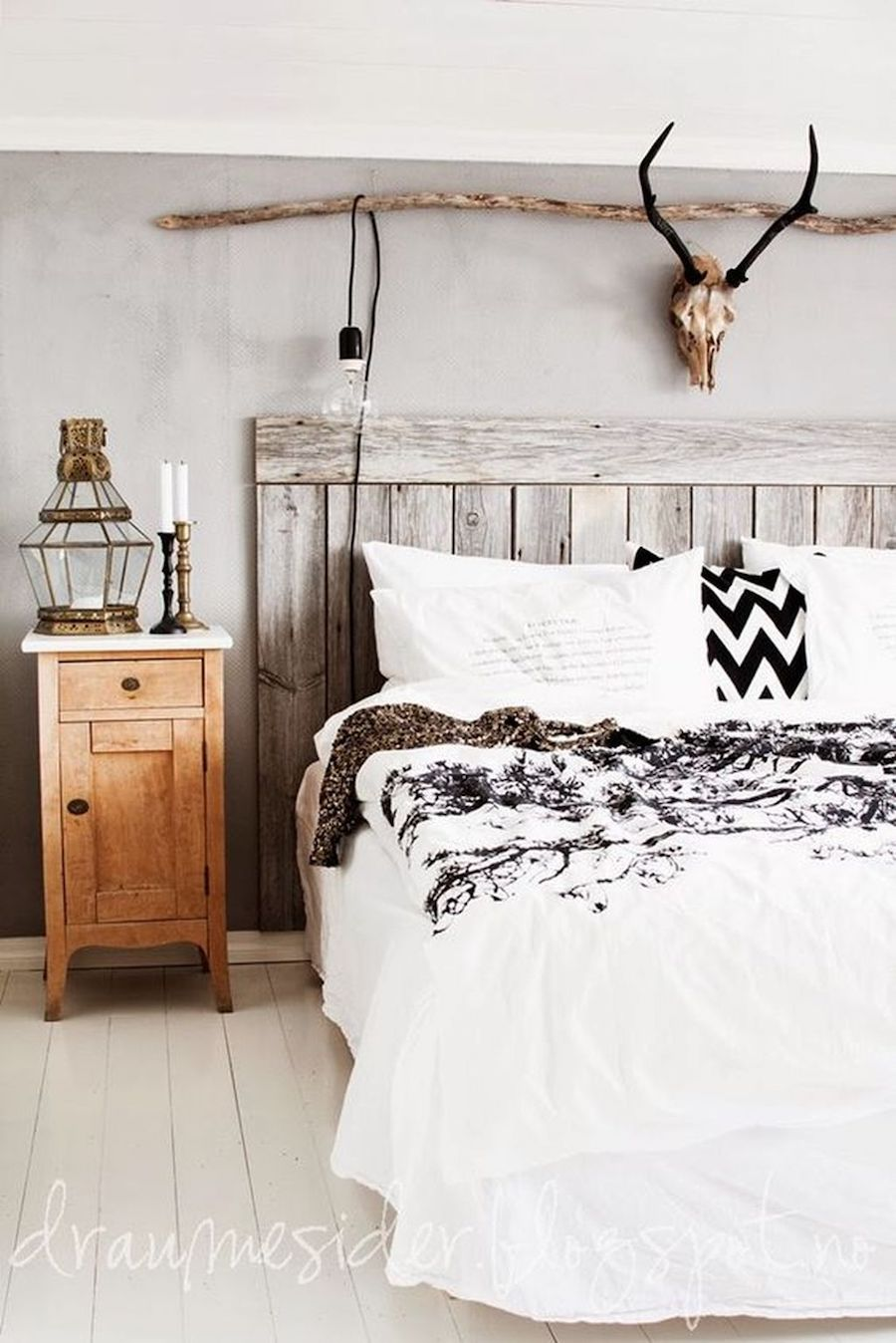Rustic Wood Panel Headboard And Antlers