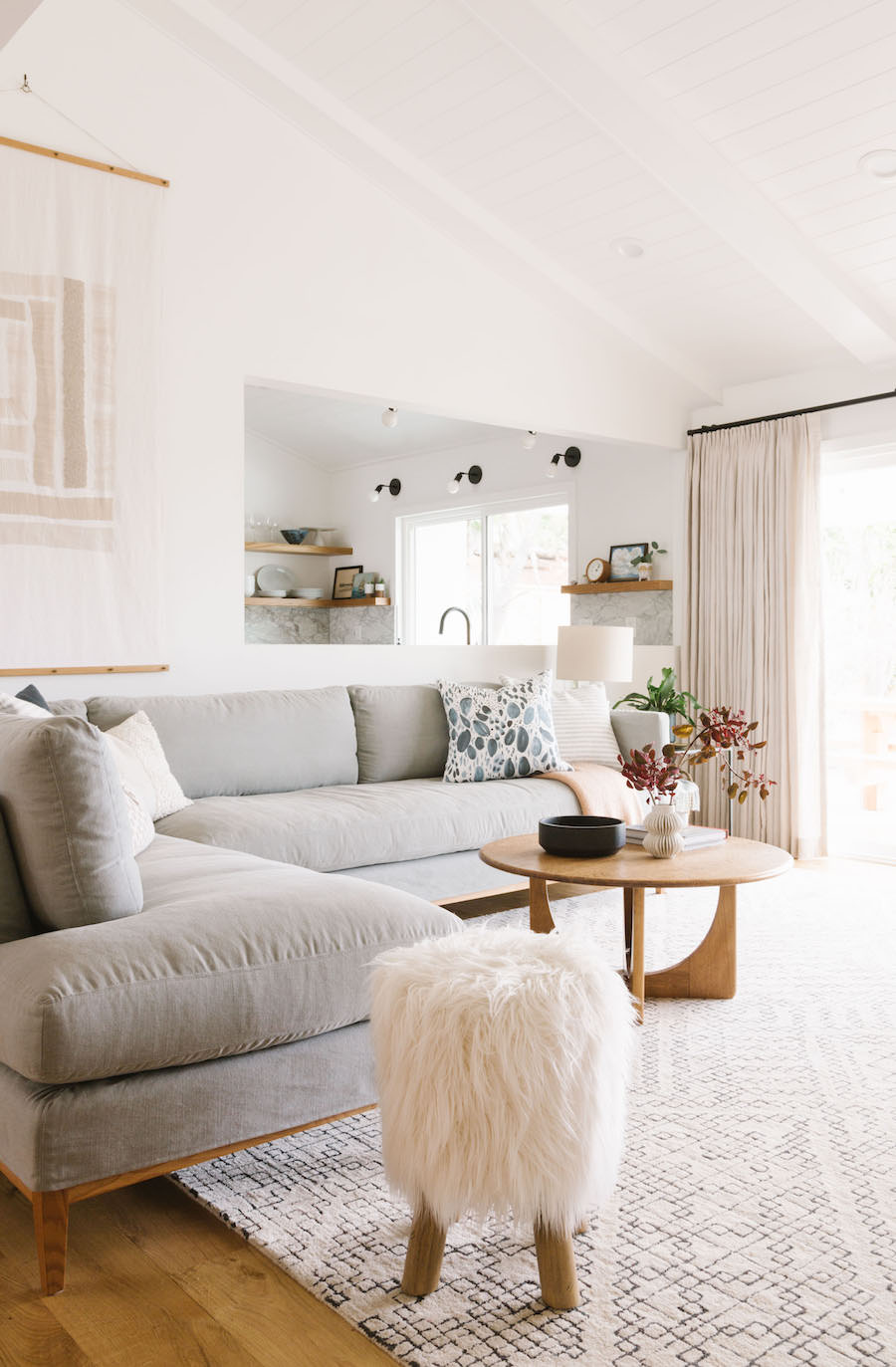 California Minimal Living Room With Light Grey Sofa And White Fur Side Stool