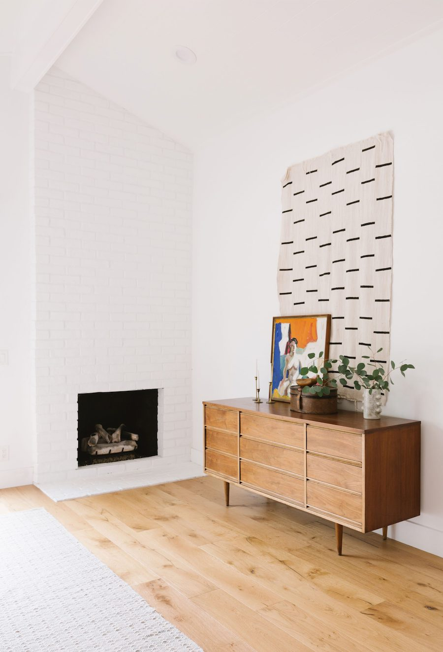 Mid Century Sideboard Next To Fireplace