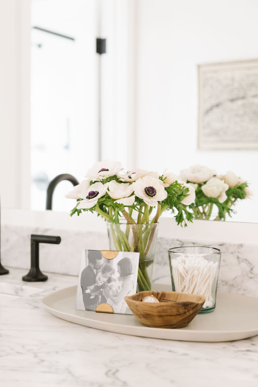 Q Tips In A Glass Cup, Marble Vanity Sink With Black Faucet