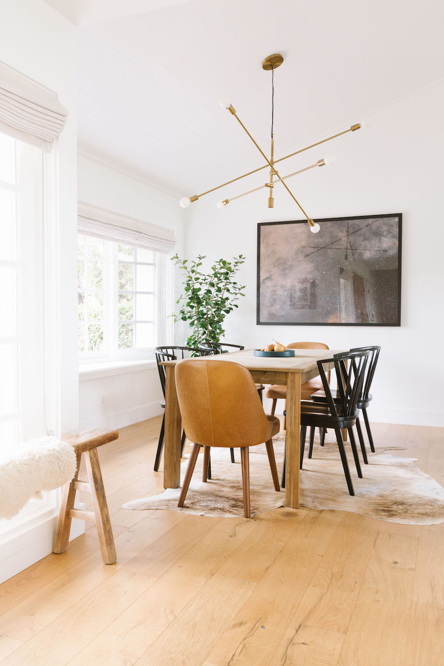 Scandinavian Minimal Dining Room With Leather Chair And Soft Brown Tones