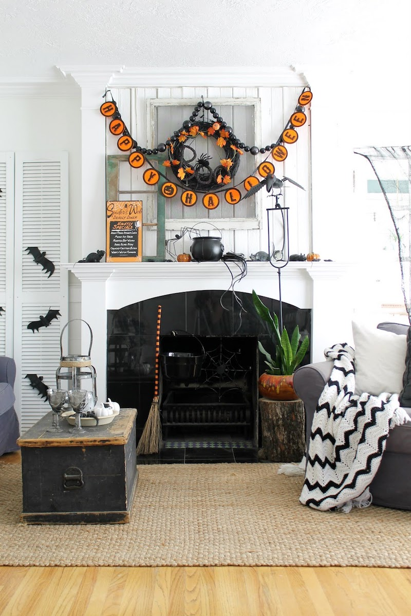 Halloween Decor Ideas Halloween Banner and Witch Broom By Fireplace