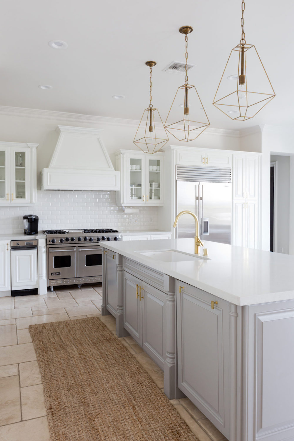 White Kitchen With Gray Cabinets And Brass Cage Lights