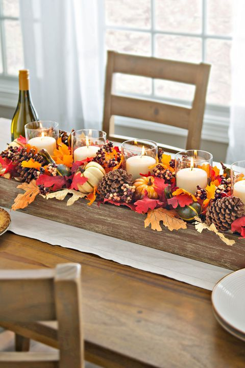 Candles And Pinecones DIY Centerpiece via Country Living