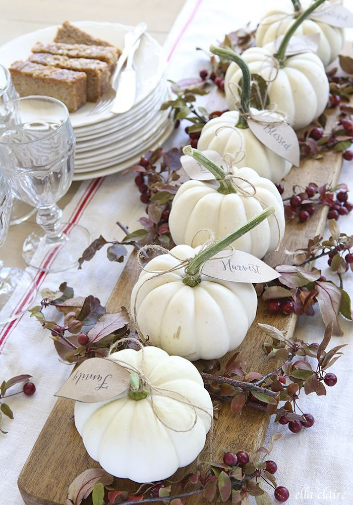 DIY Thanksgiving Centerpiece Using Pumpkin Leaves And Wood Cutting Board via Ellaclaireinspired
