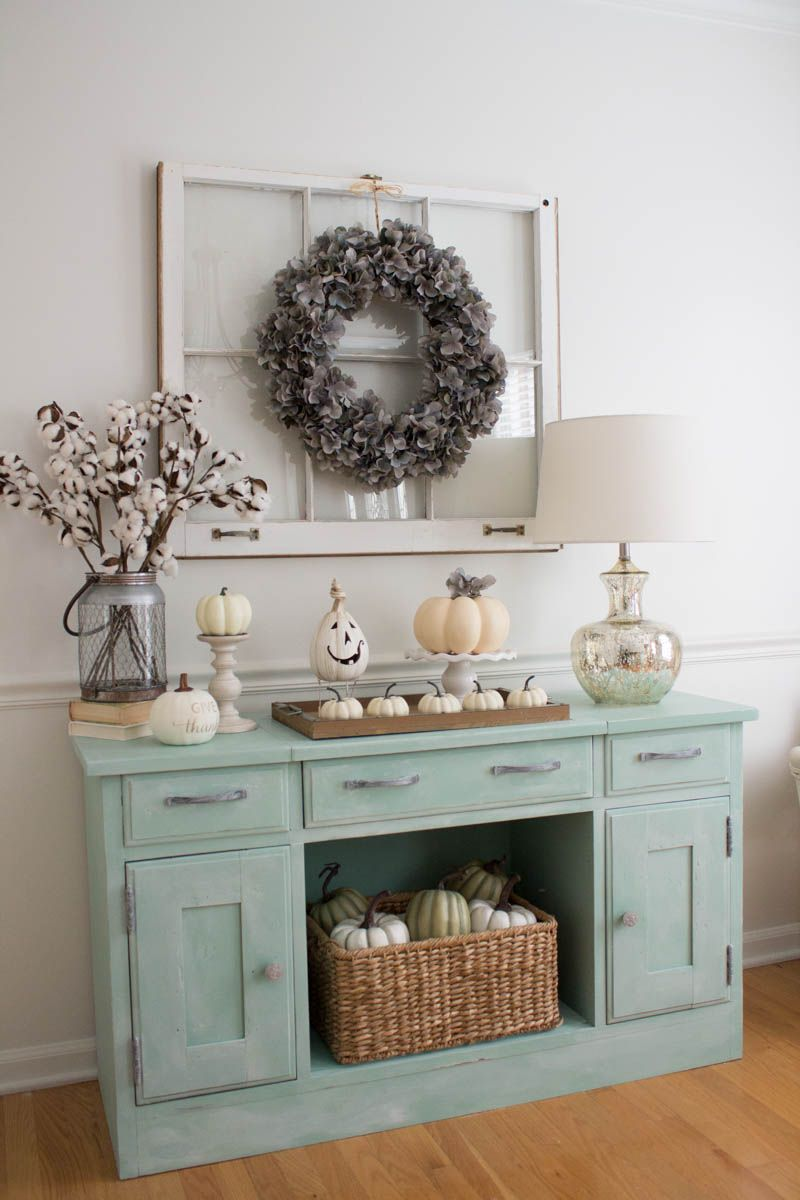 Fall Decor Ideas Cotton Ball Branches And White Pumpkins On Cake Stands And Candle Holders via Theuncoordinatedmommy