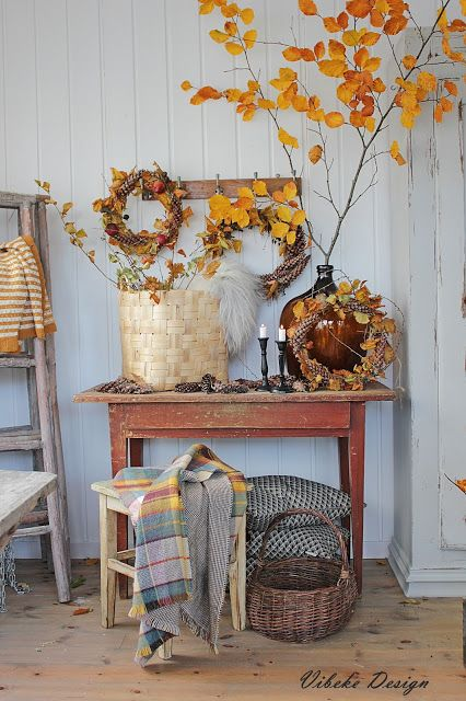 Fall Console Table With Natural Branches And Yellow Leaves via Vibekedesign