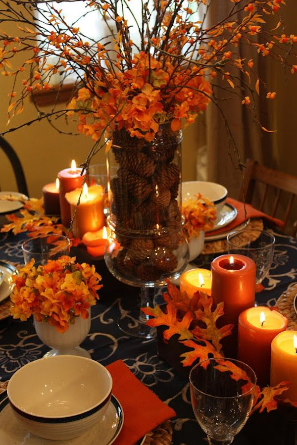 Thanksgiving DIY Centerpiece: Acorns In A Clear Vase Topped With Orange Hydrangeas via Sweet Something