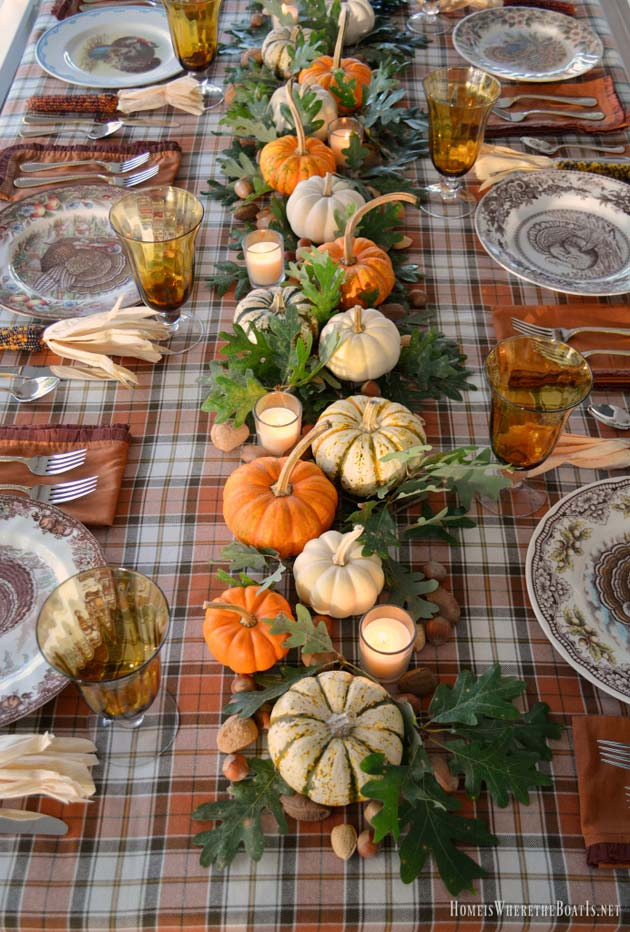 Thanksgiving Tablescape With Plaid Table Cloth via Homeiswheretheboatis