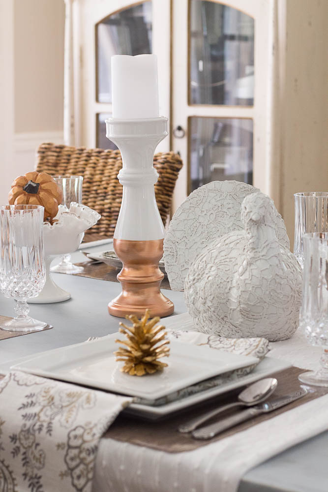 White Turkey Centerpiece And Gold Pinecone Place Setting Thanksgiving Tablescapes via Savvyapron