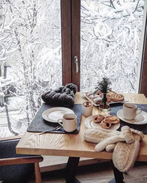 Breakfast nook overlooking a snowy forest