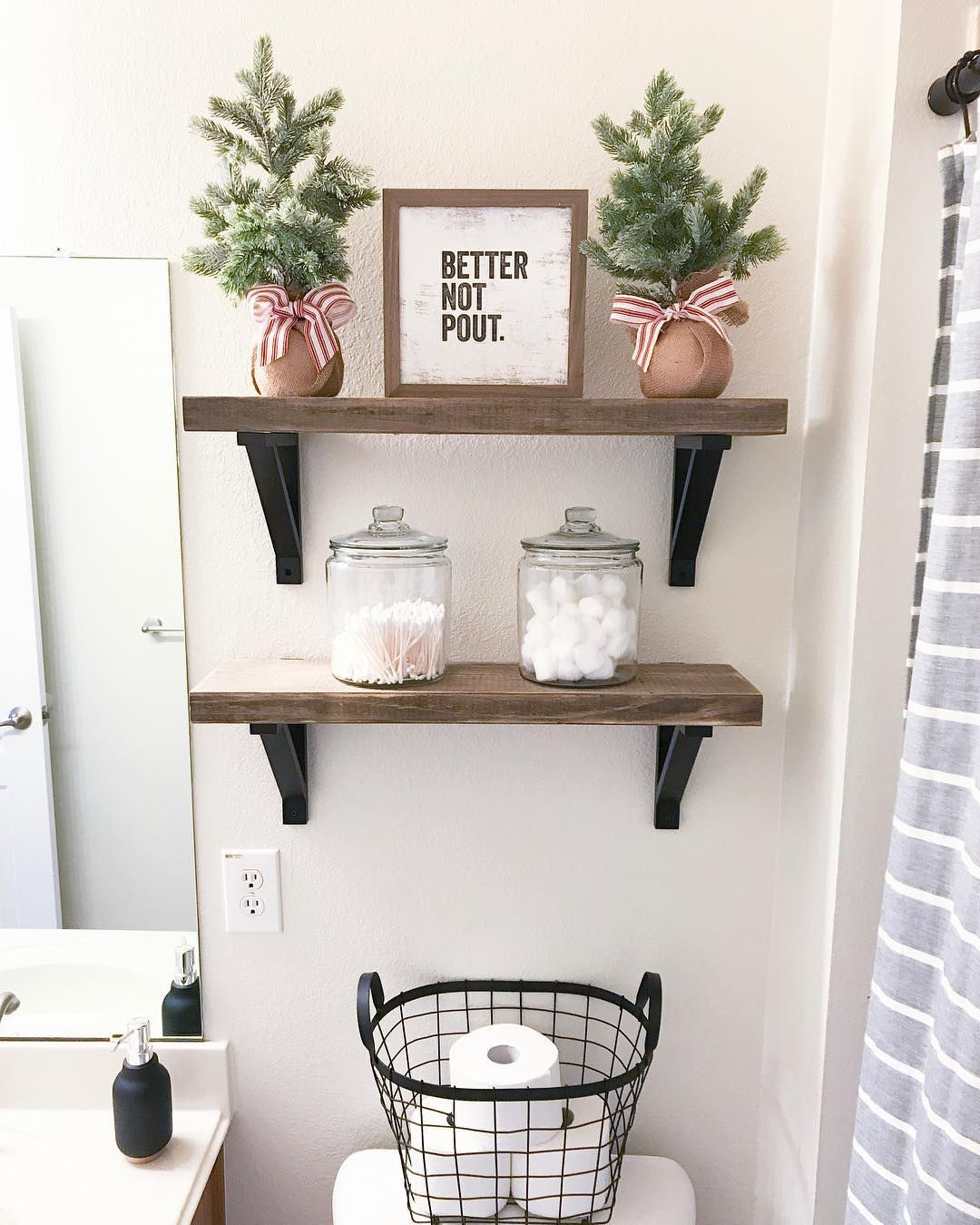 Christmas Decor on the Above Toilet Shelving in Bathroom via @simply_sweet_designs #ChristmasDecor #ChristmasBathroom