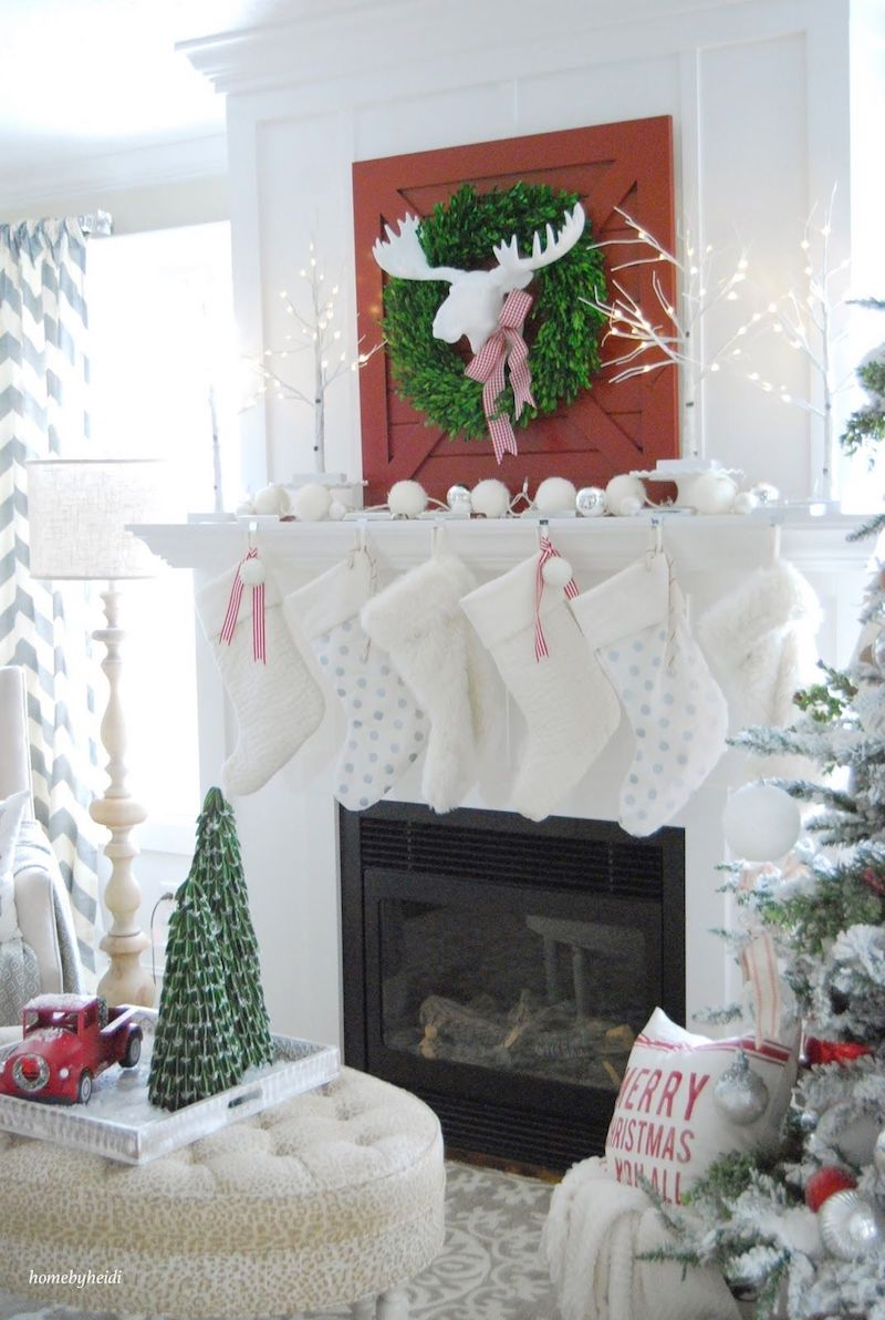 Christmas Mantel with Red Barn Door and White Stockings via 11magnolialane