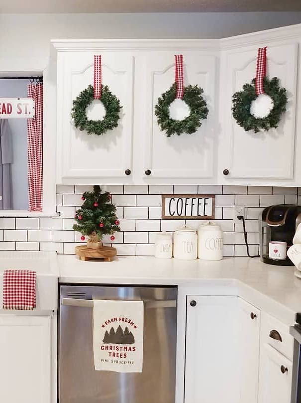 Christmas Wreaths on Kitchen Cabinets @ourcozycottage