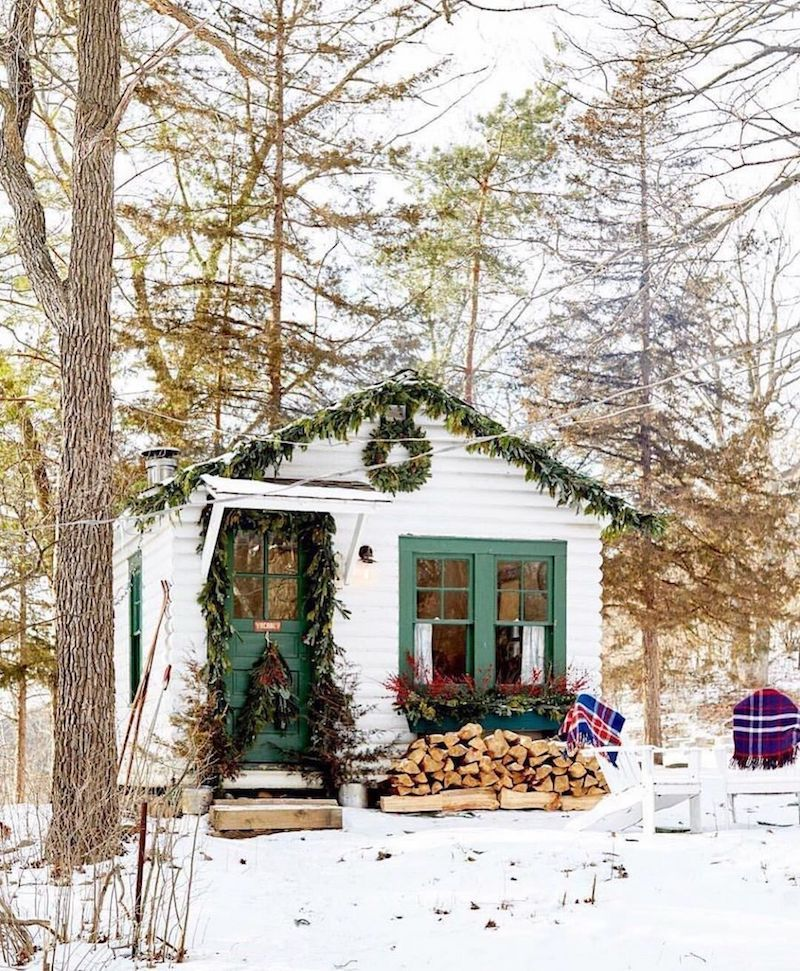 Christmas cabin in the woods decorated with Green garlands