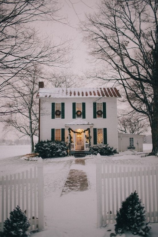 Cute white house with wreaths on the windows - Christmas House Decor