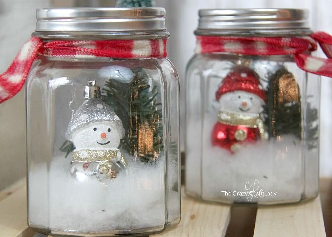 DIY Mason Jar Snow Globes for Christmas via thecrazycraftlady #Christmas #ChristmasDecor #ChristmasDIY #DIYDecor