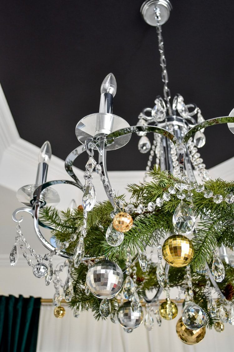 Dining Room Chandelier Decorated for Christmas via @monicawantsit #ChristmasDecor #ChristmasDiningRoom