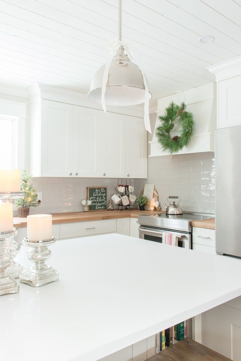 Evergreen Wreath Hanging on the Range Hood via makingitinthemountains