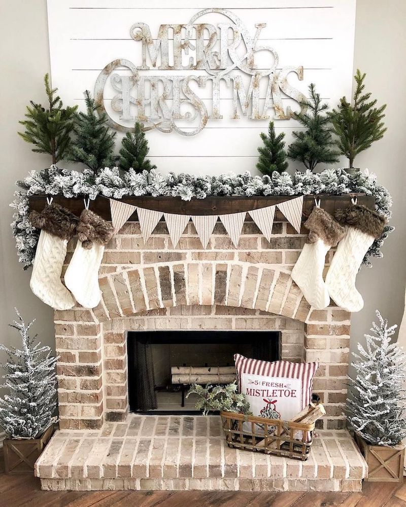 Flocked Garland Christmas Mantel via @ourfarmhousestylehome