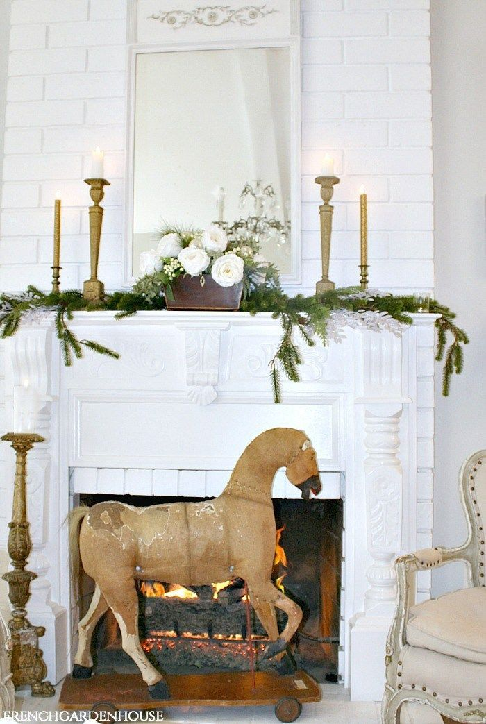 French Country Christmas Decor with Antique Horse and Fireplace via frenchgardenhouse #FrenchCountry #FrenchChristmas #FrenchCountryDecor