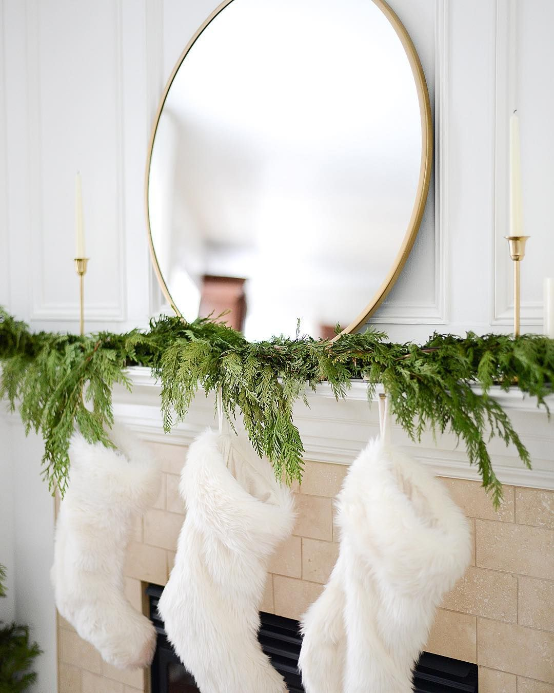 Fresh greenery, white stockings, gold mirror Christmas Mantel via @house_of_trinh_setting