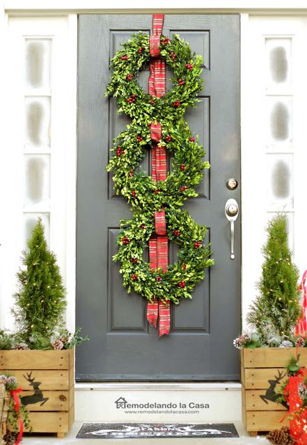 Front door with three boxwood wreaths Christmas Decor via remodelandolacasa