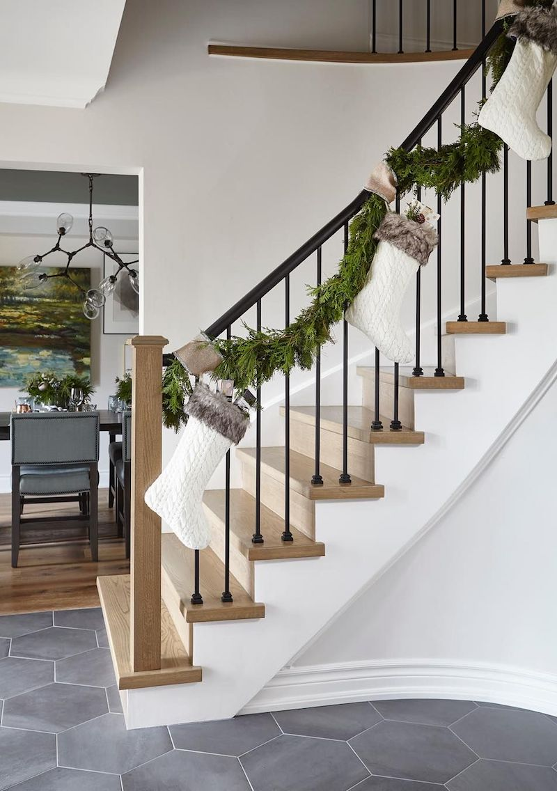 Garlands and White Stockings along the Staircase via @orsipanosinteriors