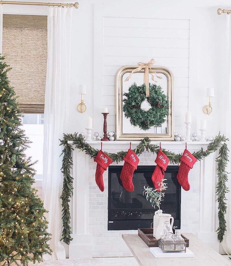 Gold mirror and Red Stockings Christmas Living Room via @alifedotowsky
