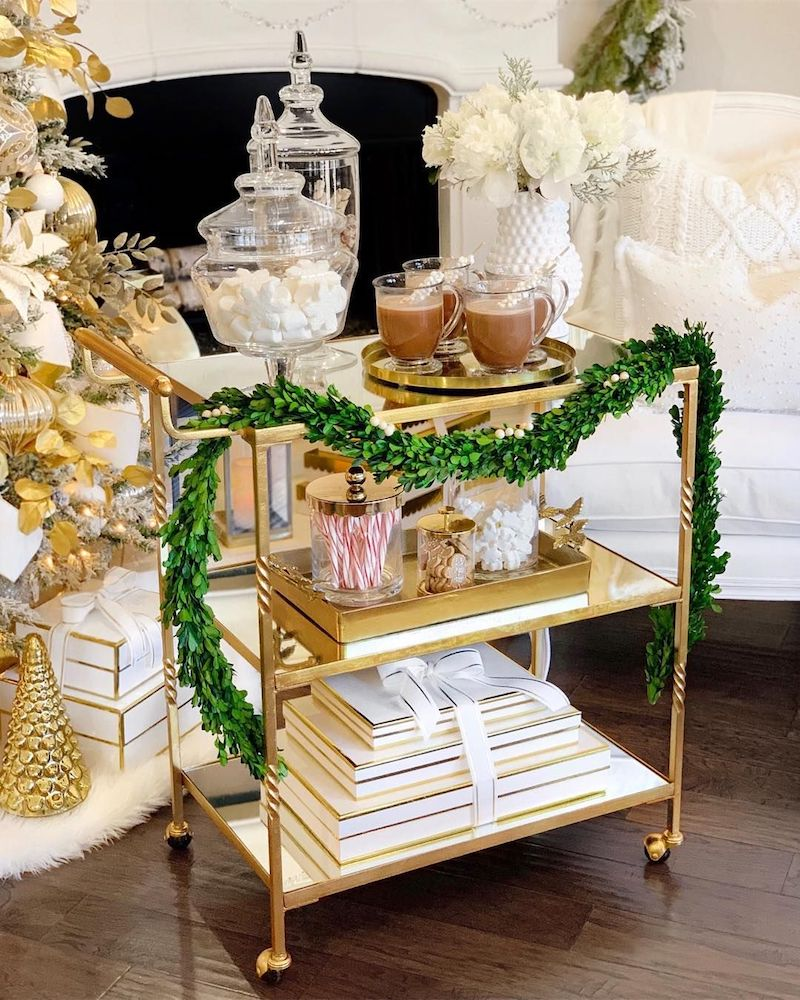 Hot Chocolate on a Gold Bar Cart with Christmas Garland via @thedecordiet