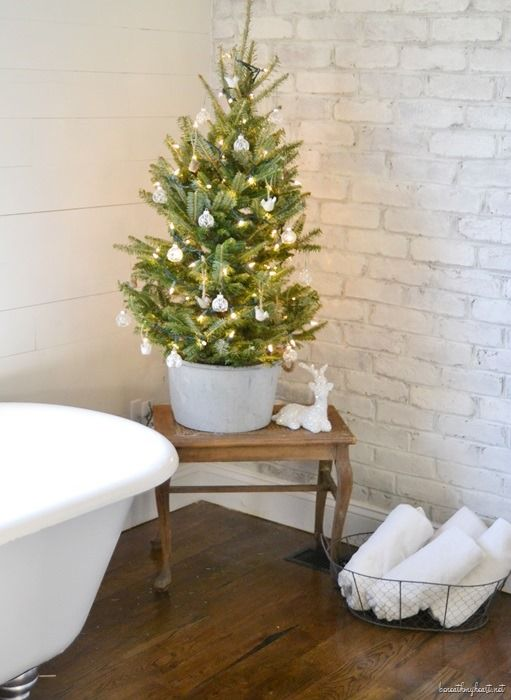 Mini Christmas Tree next to Bathtub via beneathmyheart #ChristmasDecor #ChristmasBathroom