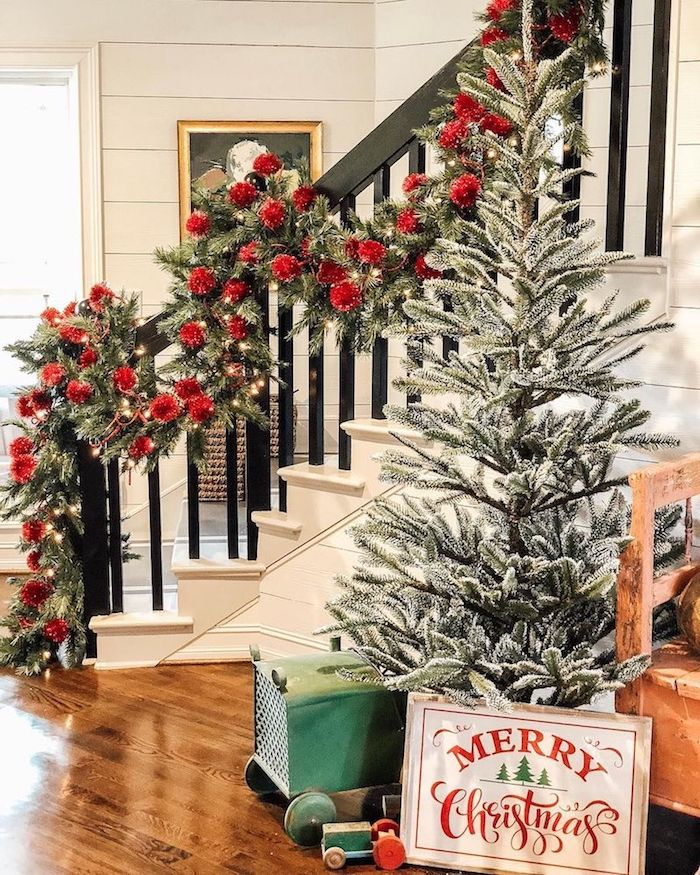 Oversized Green Garland with Red Ornaments Staircase via @farmshenanigans