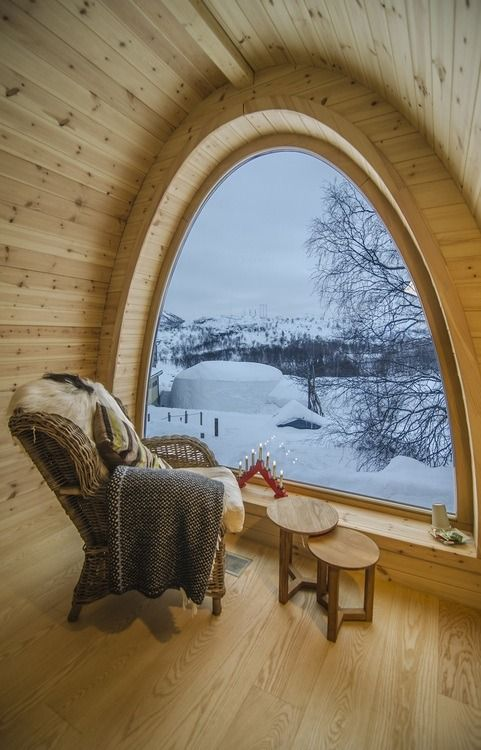Reading Chair with Arched Window overlooking Snowy Mountains