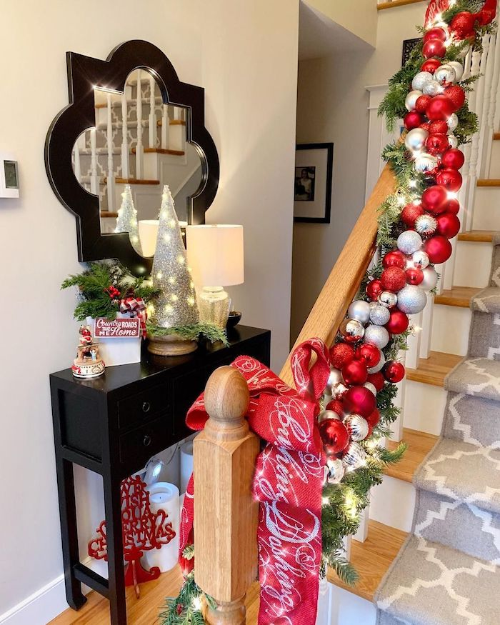 Red and Silver Ornaments Christmas Staircase Decor via @seasideinteriors