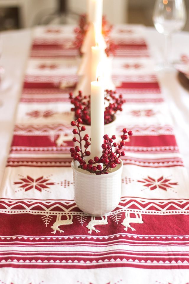 Red and white candle tablescape for Christmas via shadesofblueinteriors