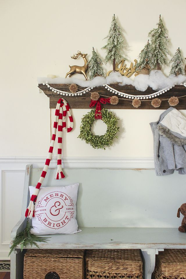 Rustic Bench at Entryway Christmas Decor via shadesofblueinteriors