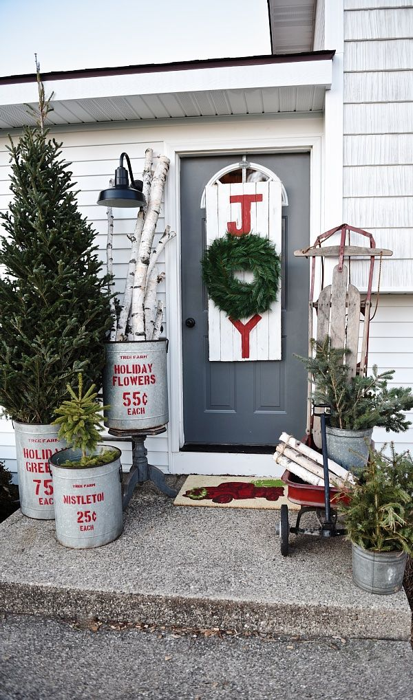 Rustic Farmhouse Front Porch Decor for Christmas via Liz Marie Blog