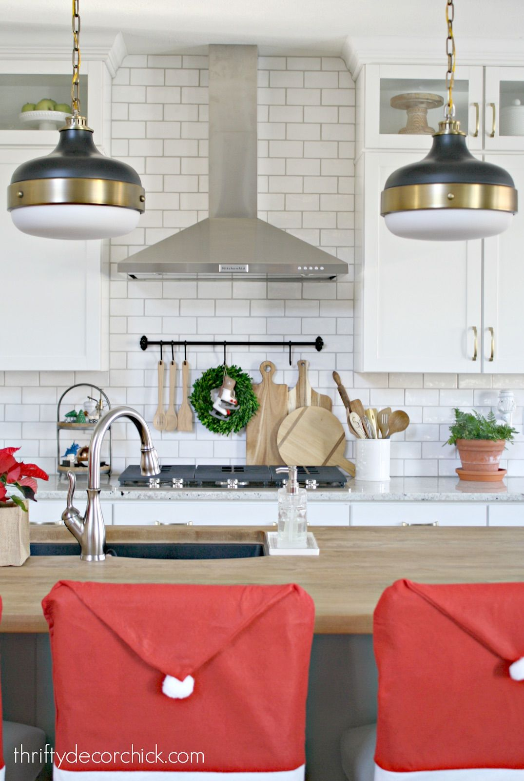 Santa Clause Chair Backs in the Kitchen via thriftydecorchick