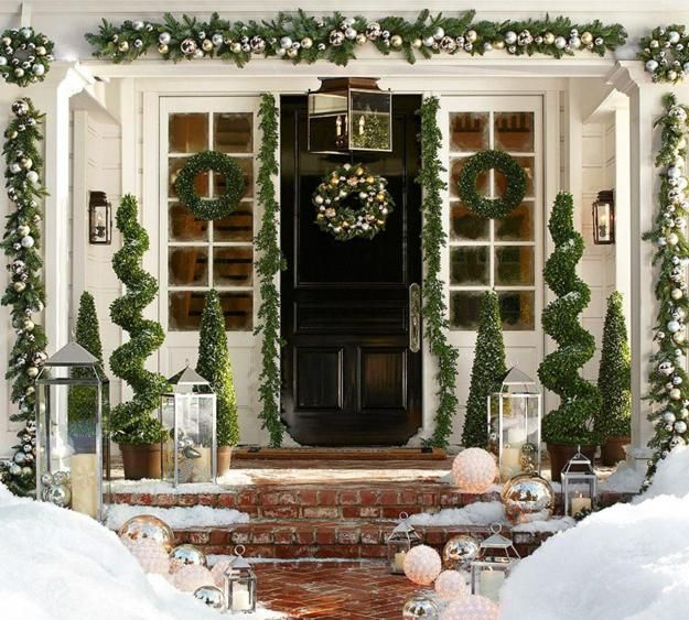 Silver ornaments and green garlands Front Porch decor for Christmas