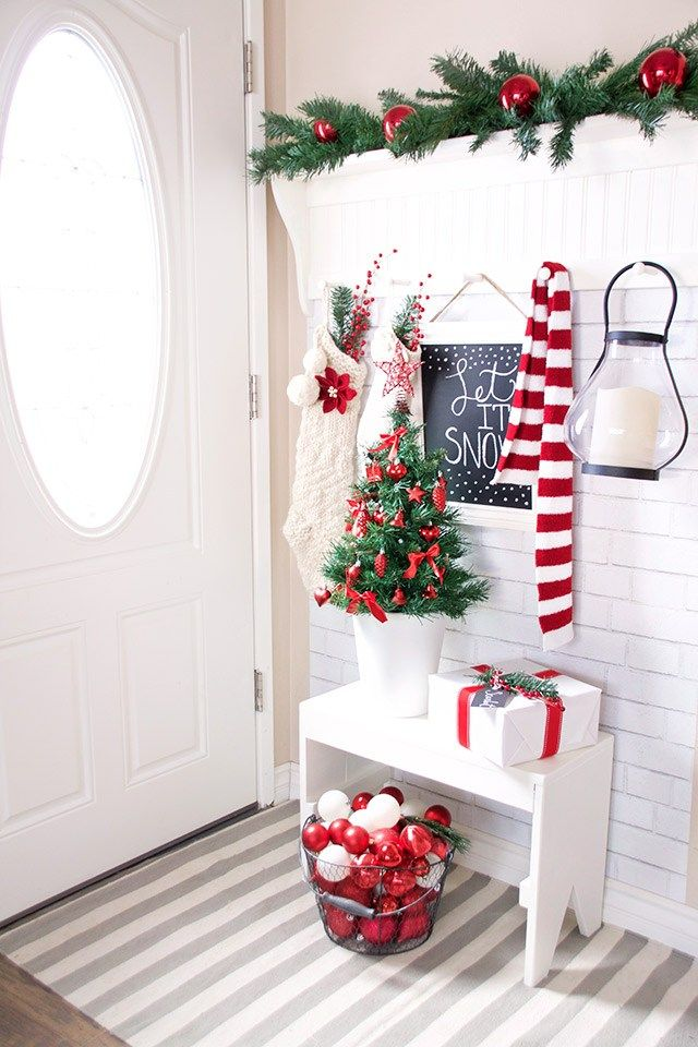 Simple Scandinavian White and Red Christmas Entryway via paint-me-pink #ChristmasDecor #ChristmasHome