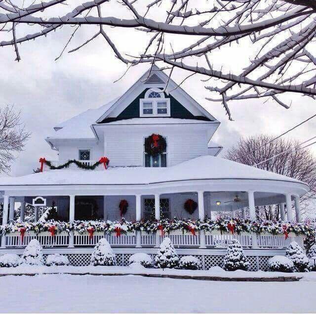 Snowy house with Christmas garland decor outside