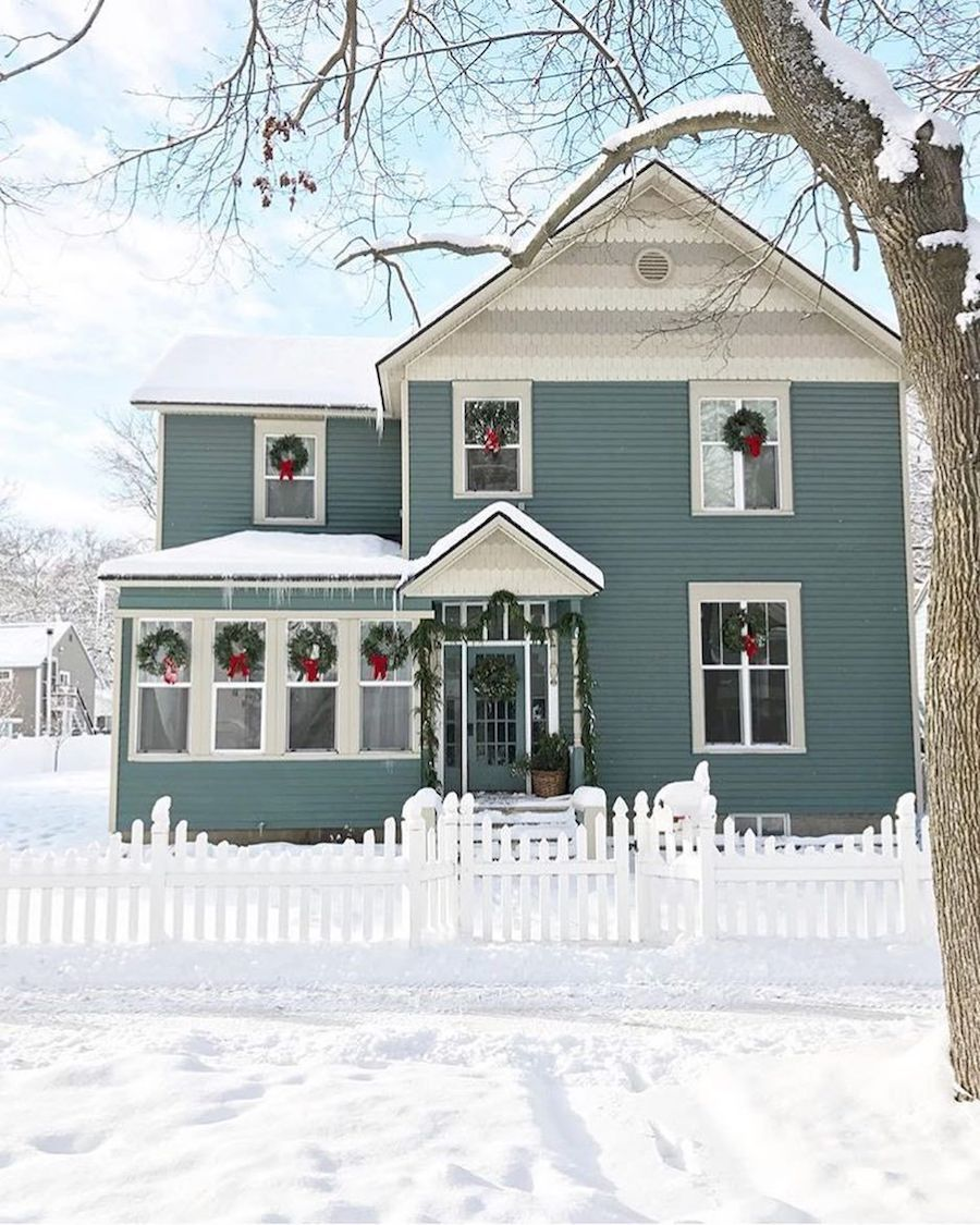 Teal House Decorated for Christmas via @themarketbeautiful