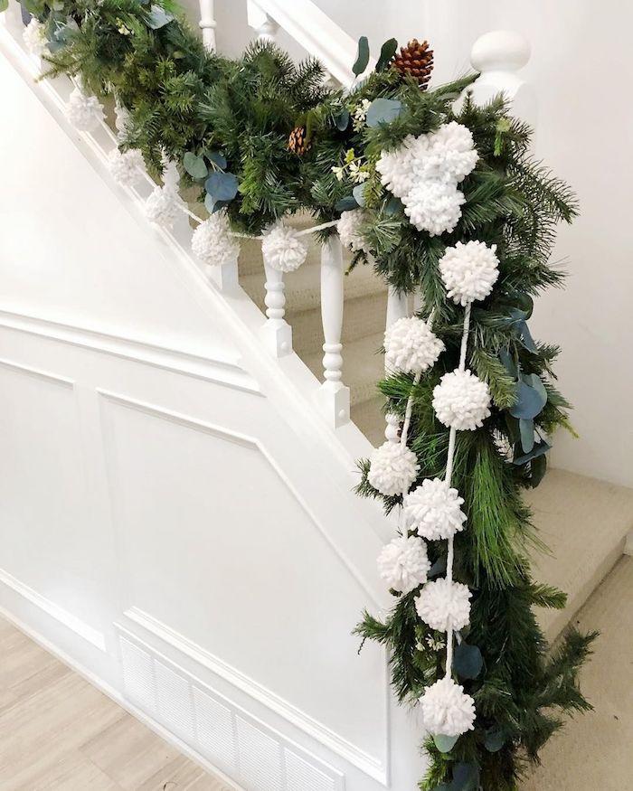White pom pom stair garland for Christmas via @mildlyminimal